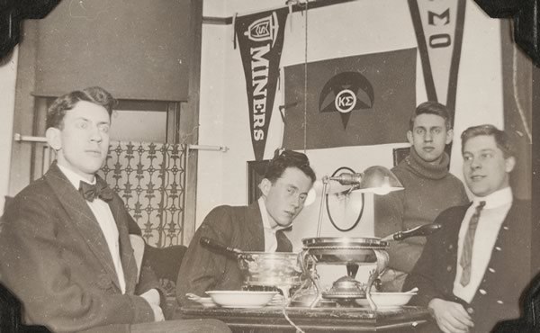 Four men in Kappa Sigma room with chafing dish
